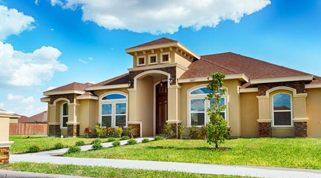 Exterior view of rustic home in sunny day in Pharr, Tx