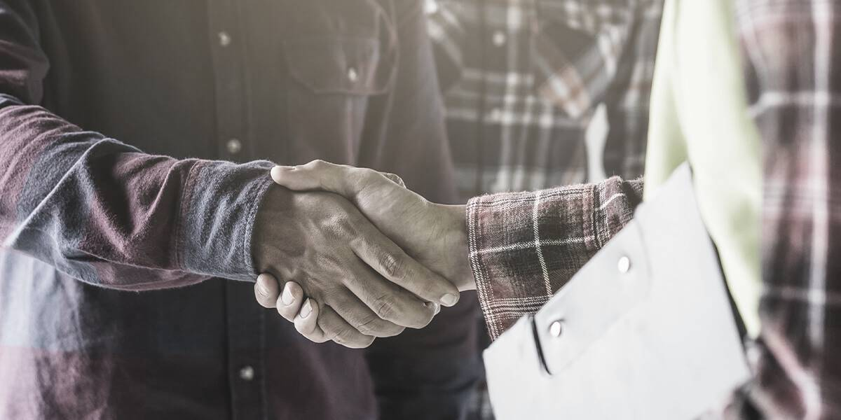 Man shaking hands with home construction worker